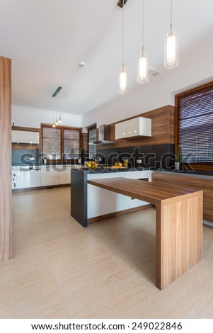 Interior of contemporary kitchen with wooden elements - stock photo