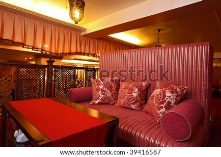 Interior of cosy modern cafe - stock photo