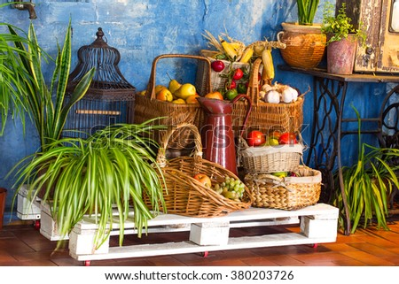 Interior of country cafe withbaskets full of fruits on pallet. Photo can be used as a whole background. - stock photo