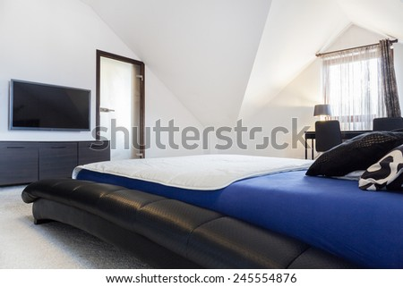Interior of designed bedroom in the attic - stock photo