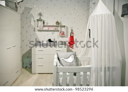 interior of designed in white color baby room - stock photo