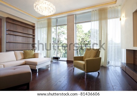 Interior of designer living room with beautiful view from window - stock photo