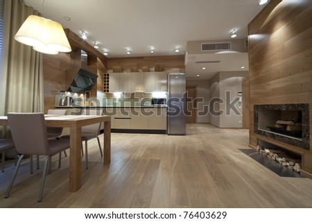 Interior of designer living room with kitchen - stock photo