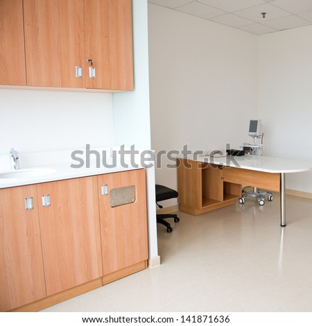 interior of doctor's working place in hospital. - stock photo