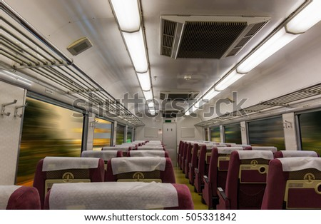 Interior of electric train with empty seats business transportation and travel background. business interior rail-car industrial.