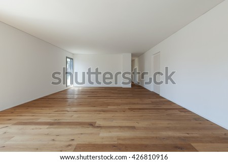 Interior of empty apartment, wide hall with parquet floor  - stock photo