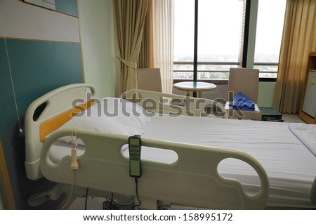 Interior of empty bed in hospital room.  - stock photo