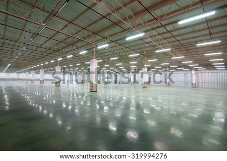 Interior of empty hall a lot of fluorescent light factory - stock photo