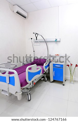 Interior of empty hospital room - stock photo