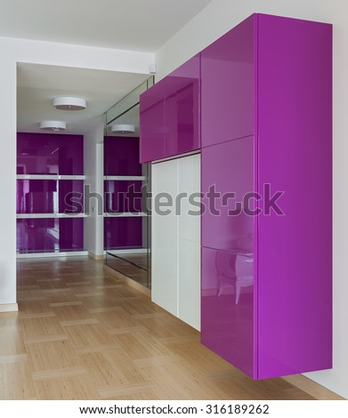 Interior of empty wardrobe room with furniture in pink colors - stock photo