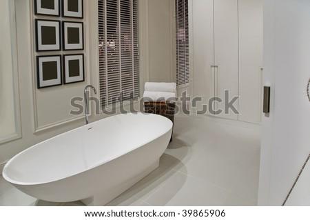 interior of empty white bathroom - stock photo
