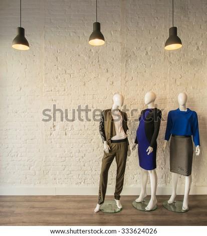Interior of fashion clothing shop - stock photo
