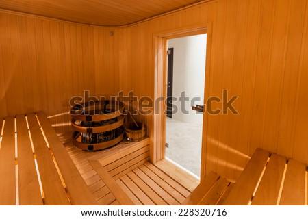 Interior of Finnish sauna, classic wooden sauna - stock photo