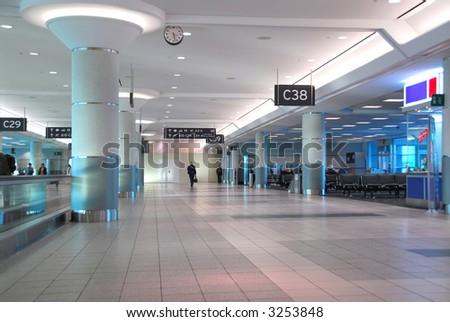 Interior of gates at modern internation airport - stock photo