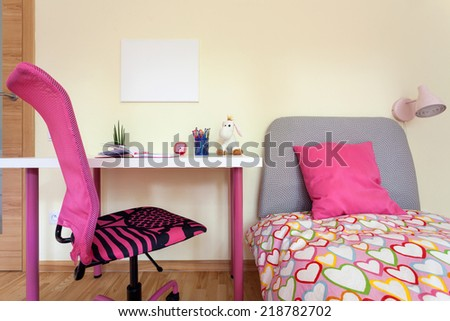 Interior of girl's room with pink decorations - stock photo