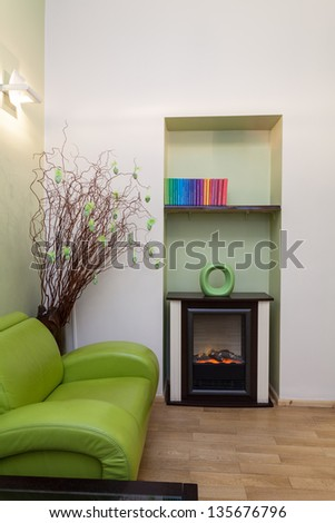 Interior of green room with colorful books - stock photo