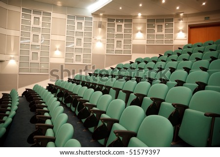Interior of hall for conferences. Rows of chairs for spectators. - stock photo