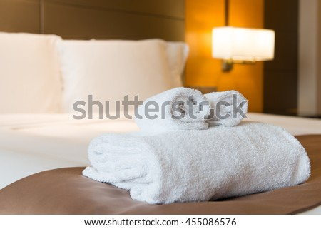 Interior of hotel bedroom with double size bed - stock photo