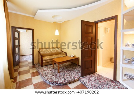 Interior of hotel suit apartment, comfortable two room with sofa and table. Modern hotel interior.  - stock photo