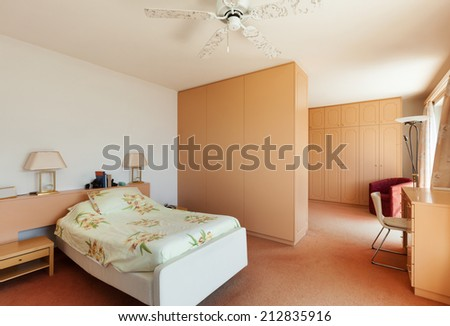 Interior of house, bedroom view, double bed - stock photo