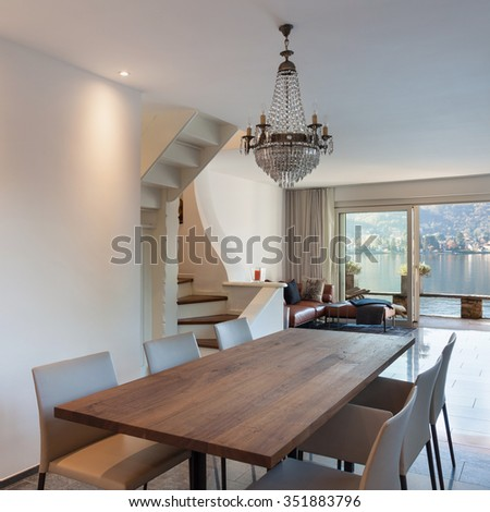 Interior of house, dining room with wooden table - stock photo