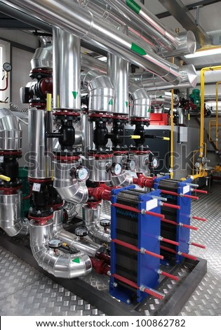 Interior of independent modern gas boiler room with manometers, valves, pumps and insulation on pipelines - stock photo