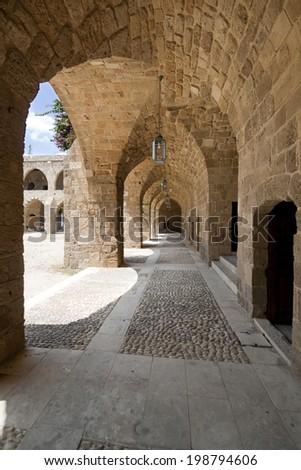 Interior of inner yard of Khan el-Franj, french caravanserai in downtown of Saida, Lebanon - stock photo