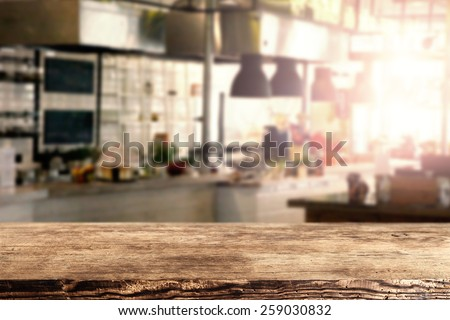 interior of kitchen in restaurant and brown retro desk space of wood  - stock photo