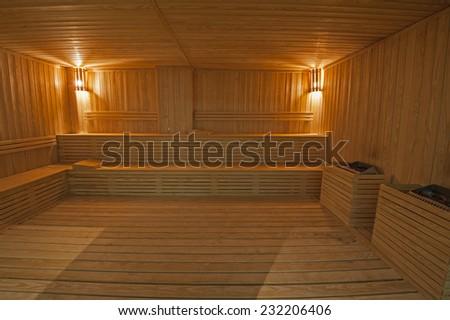 Interior of large sauna room in luxury health spa - stock photo