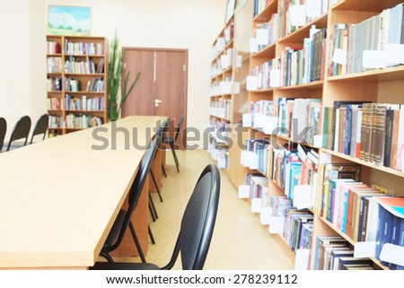 Interior of library with book shelves - stock photo