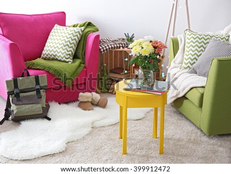 Interior of living room with beautiful flowers on table - stock photo
