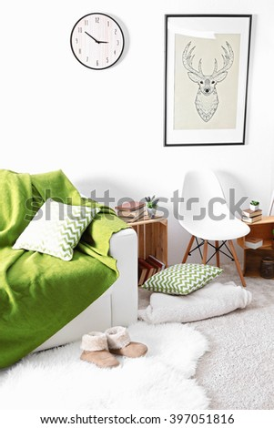 Interior of living room with couch and slippers - stock photo