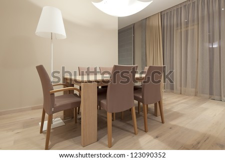 Interior of living room with dinning table - stock photo