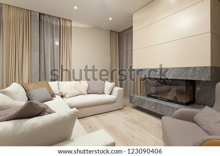 Interior of living room with fireplace - stock photo