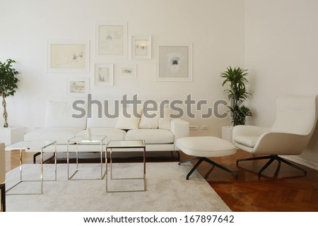 Interior of living room with white furniture - stock photo
