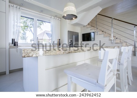 Interior of luxurious bright kitchen with marble worktop - stock photo