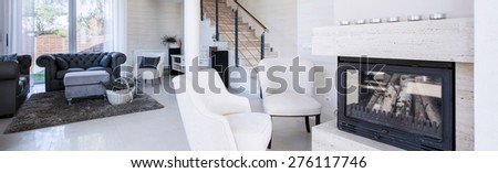 Interior of luxury living room with fireplace, panorama - stock photo