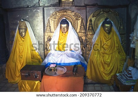 Interior of Mahabodhi temple in Bodhgaya, India. Bodhgaya is the place where Buddha got enlightenment, so it's the most sacred place of Buddhism. - stock photo