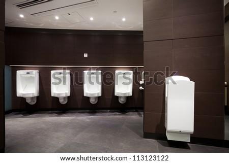 interior of male toilet - stock photo