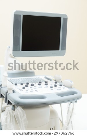 Interior of medical room with ultrasound diagnostic equipment - stock photo