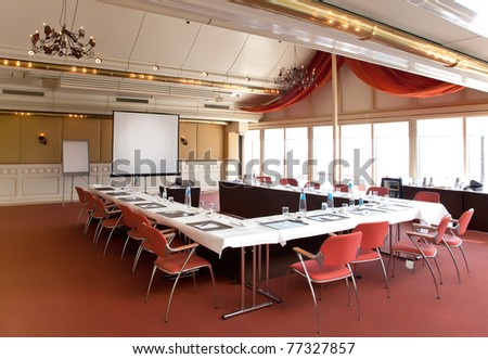 interior of meeting room with table - stock photo