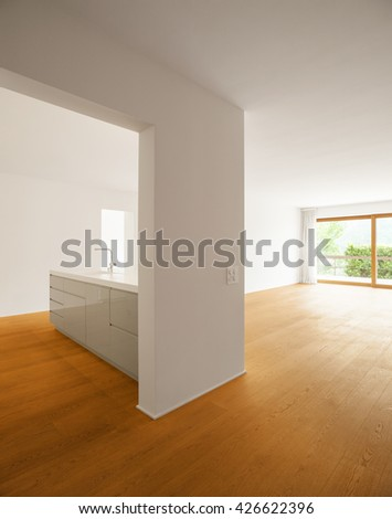 Interior of modern apartment with wooden floor