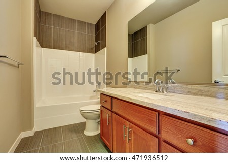 Interior of modern bathroom. Bathroom Vanity cabinet with marble top and large mirror. Northwest, USA