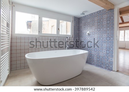 Interior of modern bathroom with free standing bath tub - stock photo