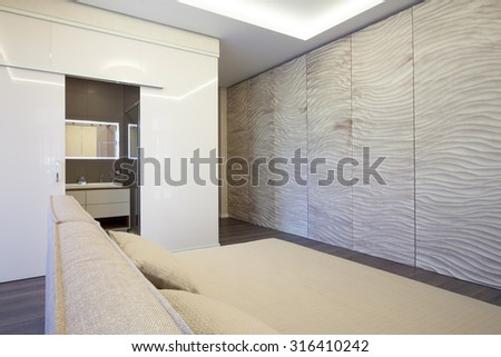 Interior of modern bedroom with bathroom - stock photo