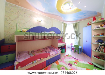 Interior of modern childrens room with colorful furniture and carpet - stock photo