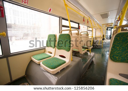 Interior of modern city bus. Seat places in back side of bus. Wide angle shot