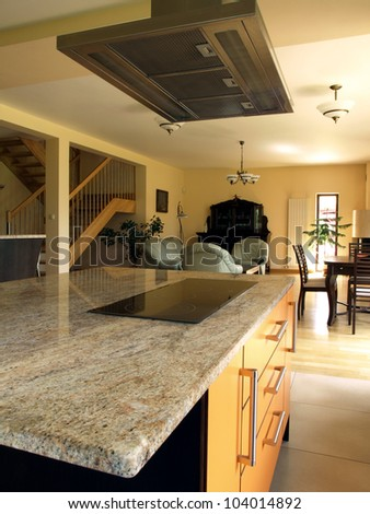 Interior of modern house: kitchen, living and dining room - stock photo