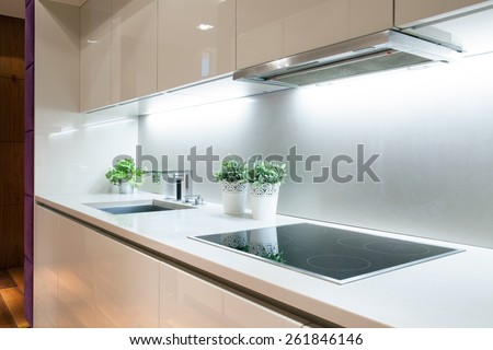 Interior of modern kitchen with induction hob - stock photo