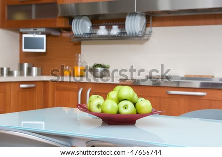 interior of modern kitchen with table and chairs - stock photo